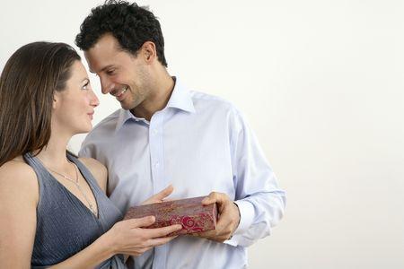 Woman giving man a present Stock Photo - 2966283
