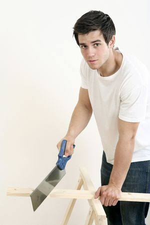 Man sawing wood Stock Photo - 2966307