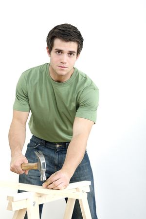 Man hammering nail into wood Stock Photo - 2966309