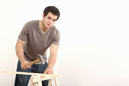 Man hammering nail into wood Stock Photo - 2966313