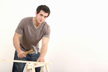 Man hammering nail into wood Stock Photo - 2966313