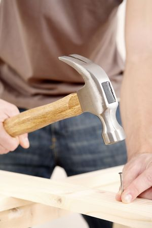 Man hammering nail into wood Stock Photo - 2966315