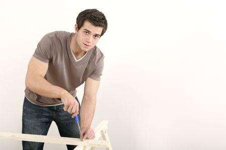 Man screwing a screw into wood Stock Photo - 2966318
