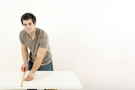 Man using tape measure on wooden board Stock Photo - 2966321