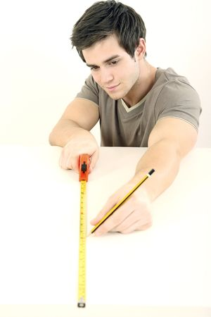 Man using tape measure on wooden board Stock Photo - 2966322
