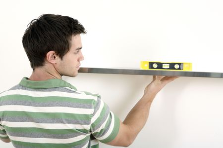 Man using spirit level Stock Photo - 2966324