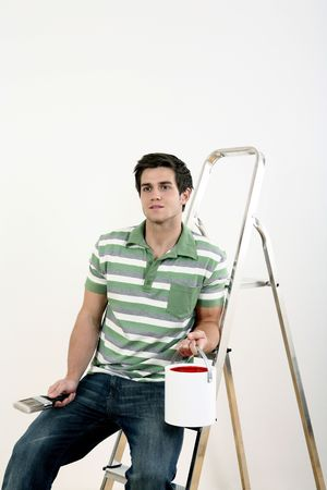 Man holding a bucket of paint and paintbrush, sitting on a ladder Stock Photo - 2966331