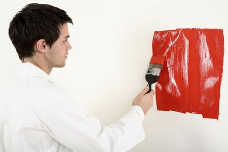 Man painting the wall red Stock Photo - 2966342