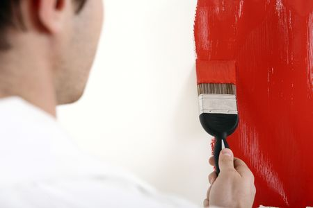 Man painting the wall red Stock Photo - 2966344
