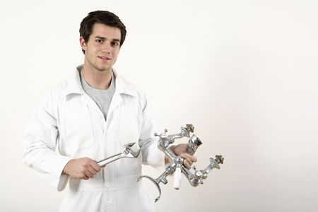 Man holding faucet and adjustable spanner in each hand Stock Photo - 2966352
