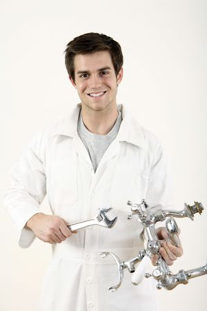 Man holding faucet and spanner in each hand Stock Photo - 2966353