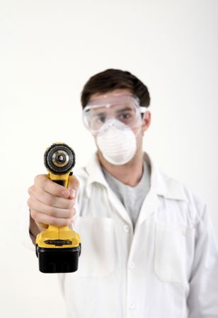 Man with safety mask and goggles pointing a power drill at the camera Stock Photo - 2966354
