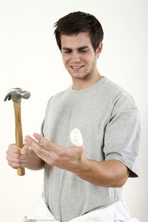 Man with hammer looking at his injured thumb Stock Photo - 2966360