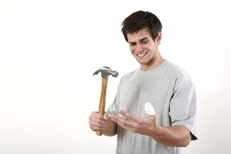 Man with hammer looking at his injured thumb Stock Photo - 2966361
