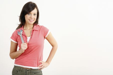 Woman with an adjustable spanner Stock Photo - 2966368