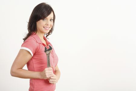 Woman with an adjustable spanner Stock Photo - 2966371