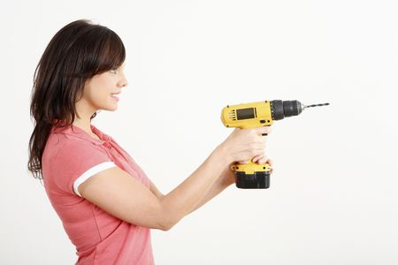 power drill: Woman with a power drill