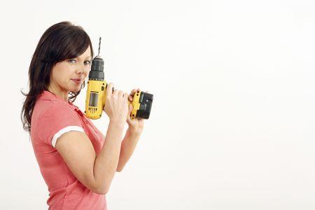 Mujer posando con una potencia de perforación  Foto de archivo - 2966374