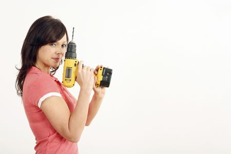 power drill: Woman posing with a power drill