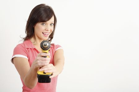 Woman posing with a power drill Stock Photo - 2966375