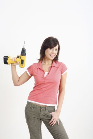 Woman posing with a power drill Stock Photo - 2966378