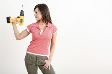 Woman posing with a power drill Stock Photo - 2966379
