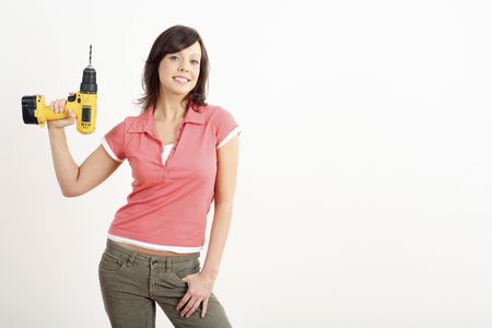 Woman posing with a power drill Stock Photo - 2966380