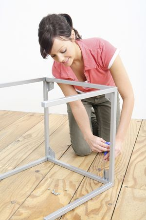 Woman assembling a table Stock Photo - 2966383