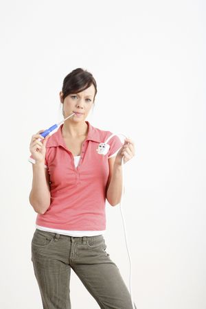 Woman holding electric plug and screwdriver photo