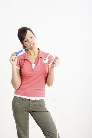 electric plug: Woman holding electric plug and screwdriver LANG_EVOIMAGES