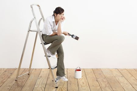 Woman with paintbrush sitting on a ladder Stock Photo - 2966398