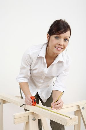Woman measuring wood Stock Photo - 2966417