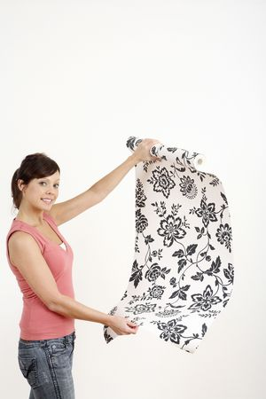 Woman holding a roll of wallpaper Stock Photo - 2966425