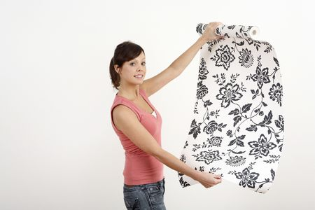 Woman holding a roll of wallpaper Stock Photo - 2966426