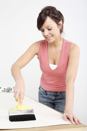 Woman applying glue on wallpaper Stock Photo - 2966432
