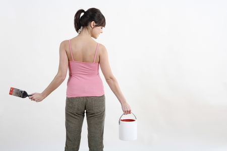Woman holding paintbrush and a paint can Stock Photo - 2966451