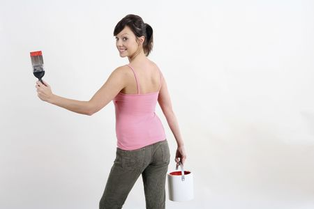 Woman holding paintbrush and a paint can Stock Photo - 2966453