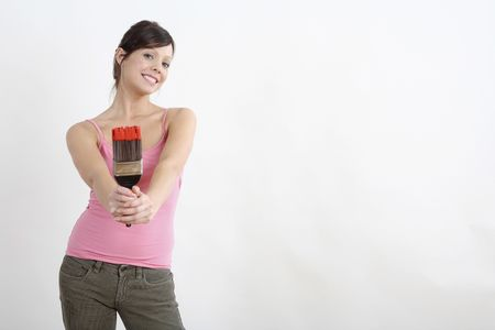 Woman holding paintbrush with paint on it Stock Photo - 2966456