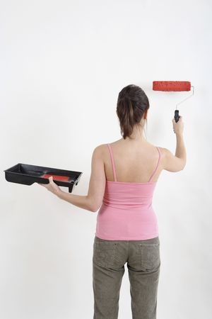 Woman painting wall with paint roller Stock Photo - 2966461