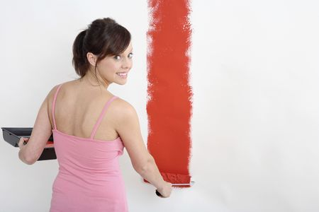 Woman painting wall with paint roller Stock Photo - 2966467