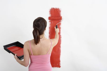 Woman painting wall with paint roller Stock Photo - 2966471