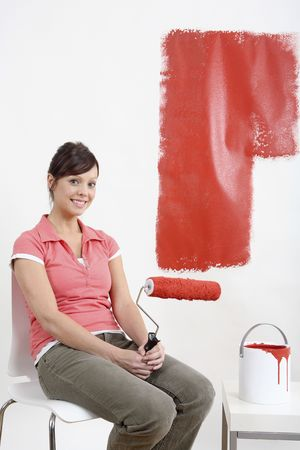 Woman holding paint roller with paint on it Stock Photo - 2966476