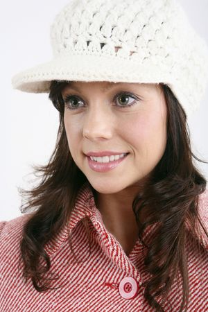 Woman in hat smiling while looking away photo