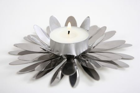 candle holder: A tealight candle on its creative holder