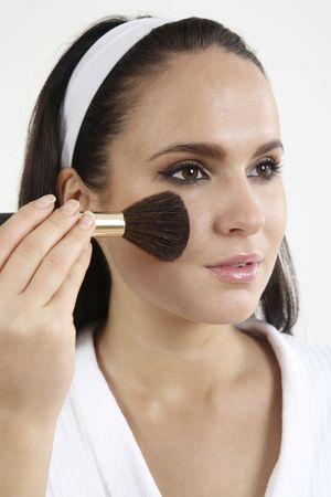 Woman applying blusher on her cheeks Stock Photo - 2966499