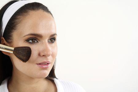 Woman applying blusher on her cheeks Stock Photo - 2966507