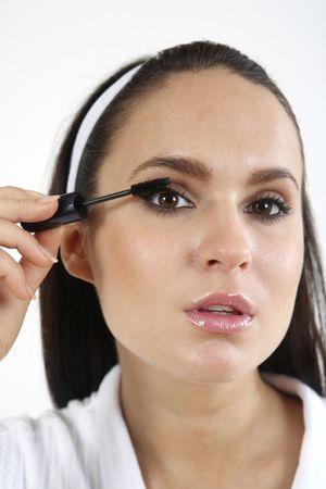 Woman applying mascara on her eyelashes Stock Photo - 2966510