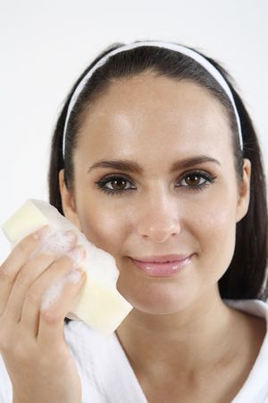 Woman in bathrobe holding a sponge with soap suds Stock Photo - 2966518