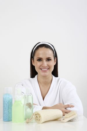 Woman with body care products arranged beside her Stock Photo - 2966534