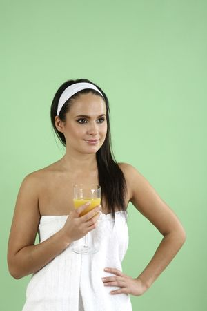 Woman wrapped in towel holding a glass of orange juice Stock Photo - 2966541